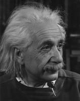 Albert Einstein shown in 3/4 profile with pen clip showing on the collar of his sweatshirt, n.d.