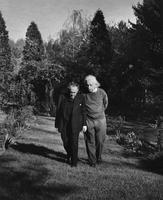 Albert Einstein and Otto Nathan walking in garden, n.d.