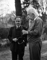 Albert Einstein smoking in garden with Otto Nathan, n.d.